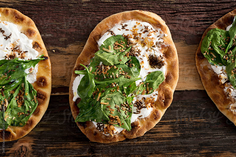Spinach Yogurt Flatbread Naan Pizza by Jeff Wasserman for Stocksy United