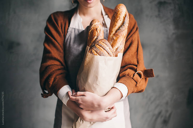 Caucasian Woman Holding Bread by Lumina for Stocksy United
