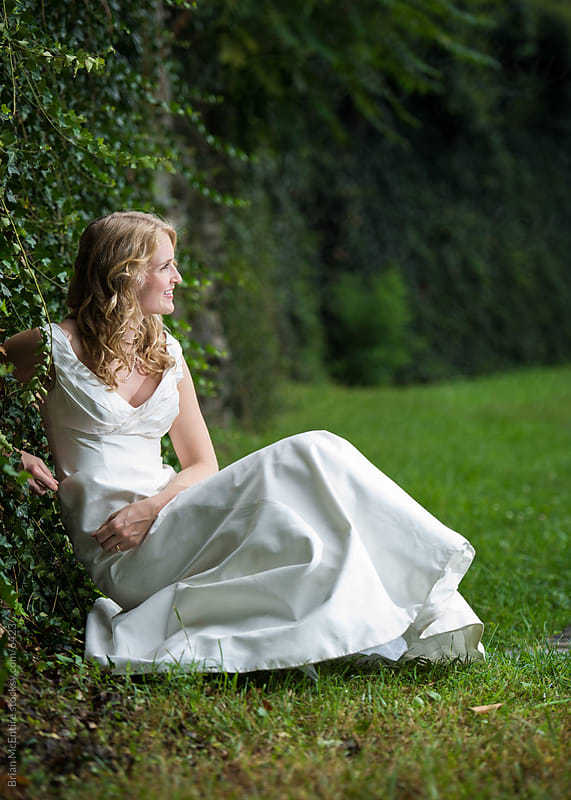 Bride in Green Timeless Natural Setting by Brian McEntire for Stocksy United