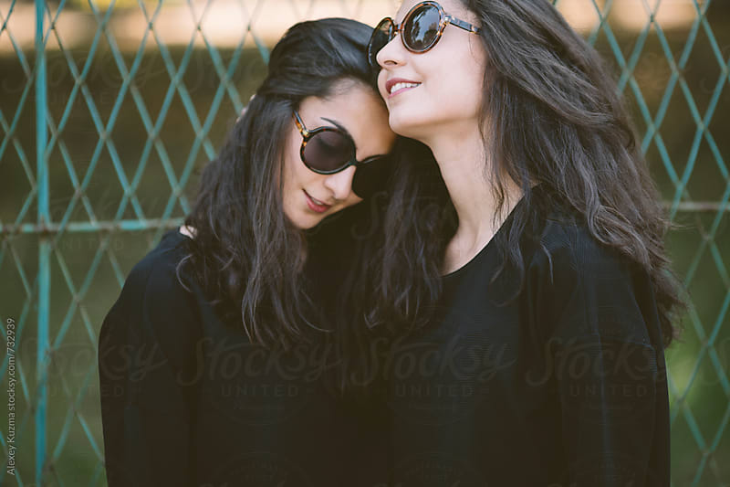 portrait of young women with retro sunglasses  by Alexey Kuzma for Stocksy United