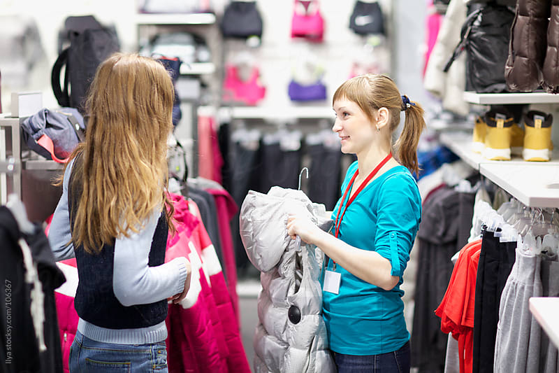 Young woman shopping for clothes by Ilya for Stocksy United