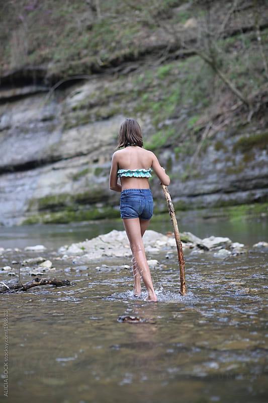 Girl Walking Upstream In A River by ALICIA BOCK for Stocksy United