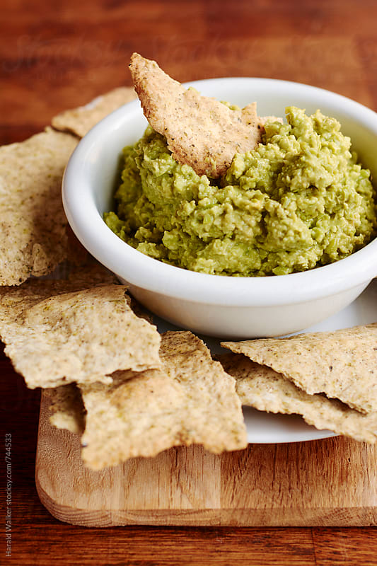 Home-made Herbed Crackers with Avocado Pea Spread by Harald Walker for Stocksy United