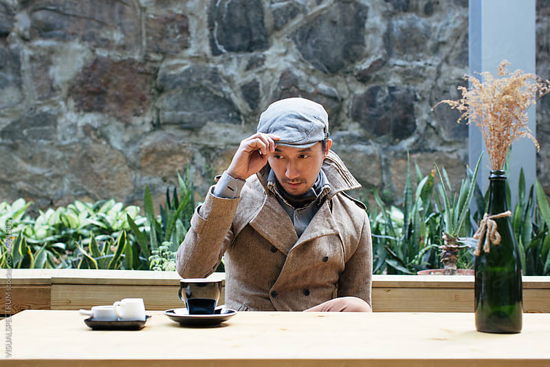 Outdoor Portrait of Well-Dressed Young Asian Man in Coffee Shop by VISUALSPECTRUM for Stocksy United