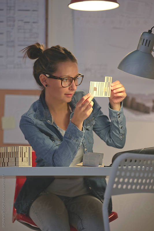 Young architect woman working in her office. by BONNINSTUDIO for Stocksy United