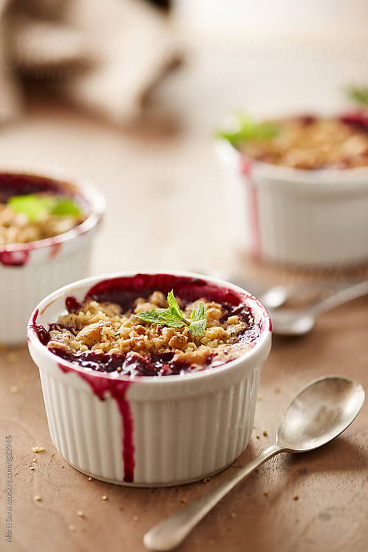 Close-up of berry crumble by Martí Sans for Stocksy United
