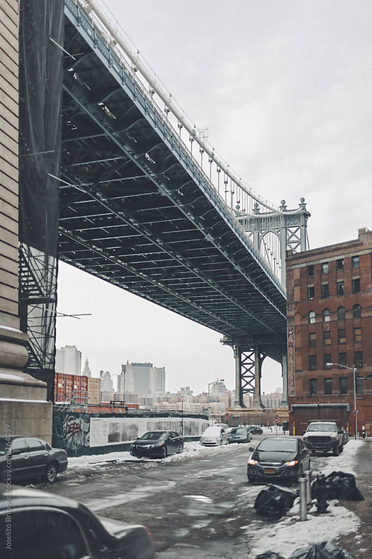 Manhattan Bridge in Winter as seen from Dumbo in Brooklyn by Joselito Briones for Stocksy United