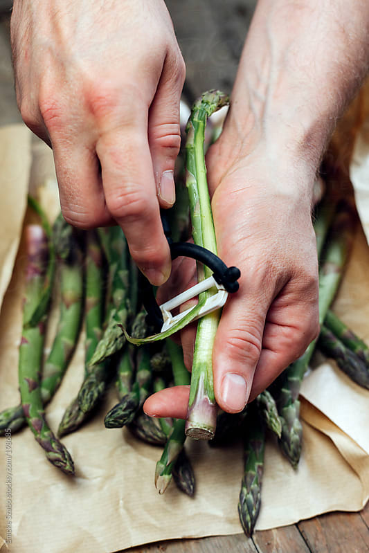 Peeling fresh asparagus by Emoke Szabo for Stocksy United