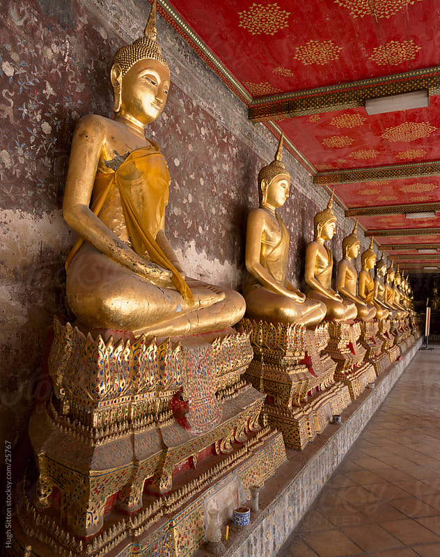 Row of seated buddhas. Wat Benchamabophit (The Marble Temple) by Hugh Sitton for Stocksy United