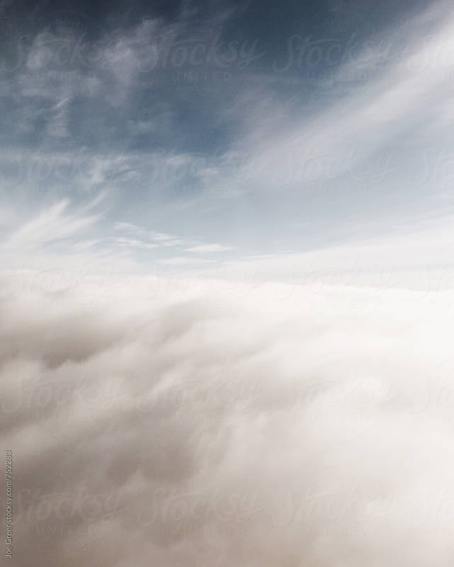 In the Clouds  by Joe Greer for Stocksy United