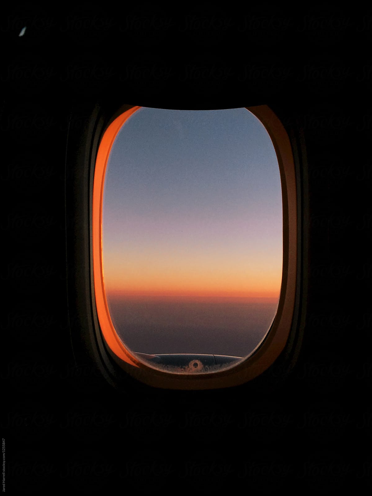 Airplane Window Seat View Of Sunset Overlooking Doha