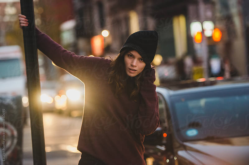 Beautiful young woman in the street by Lauren Naefe for Stocksy United