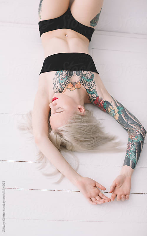 blond woman on the white background  by Vesna for Stocksy United