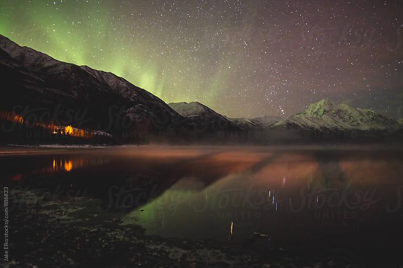 Raging Eklutha Northern Lights by Jake Elko for Stocksy United
