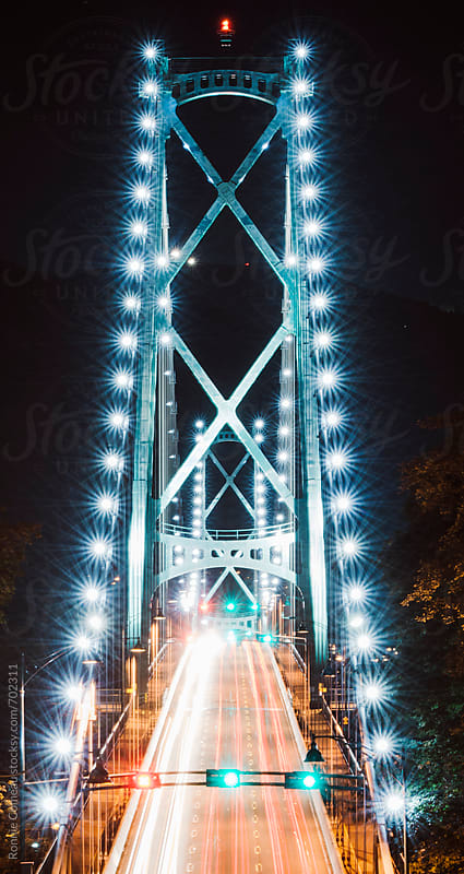 Fantastical Lights On A Bridge by Ronnie Comeau for Stocksy United
