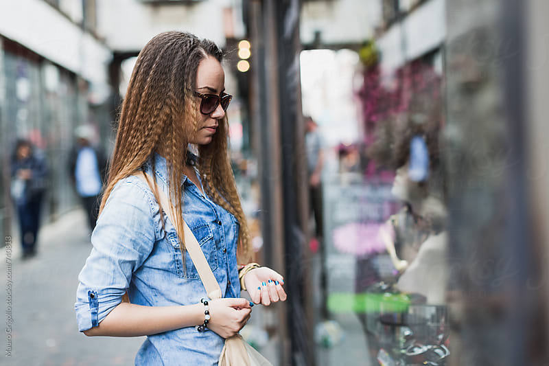 Young woman during shopping by Mauro Grigollo for Stocksy United