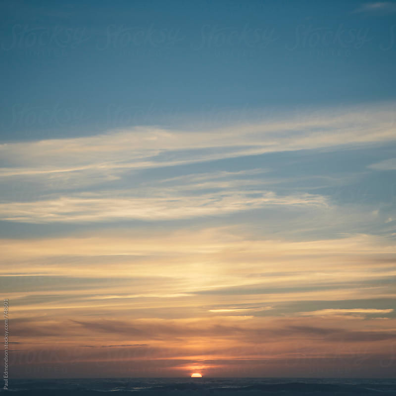 Sunset over Pacific Ocean by Paul Edmondson for Stocksy United