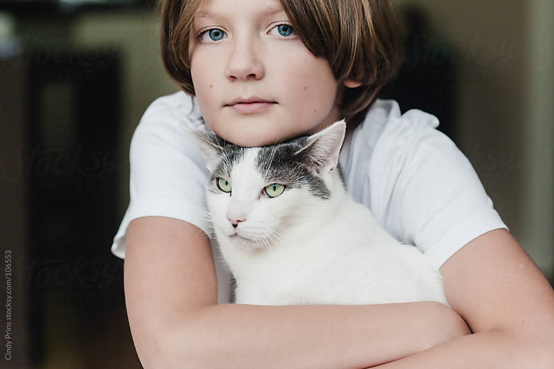 Portrait of a boy and his cat by Cindy Prins for Stocksy United