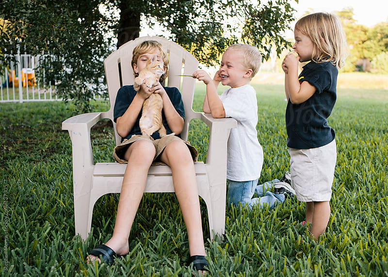 Kids Playing with Kitten by Stephen Morris for Stocksy United