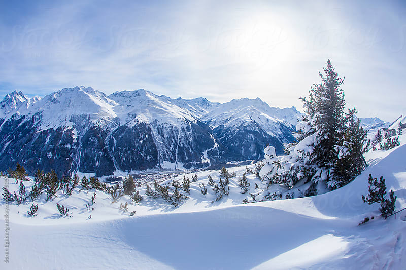 Alpine valley in Austria covered in winter snow by Søren Egeberg Photography for Stocksy United