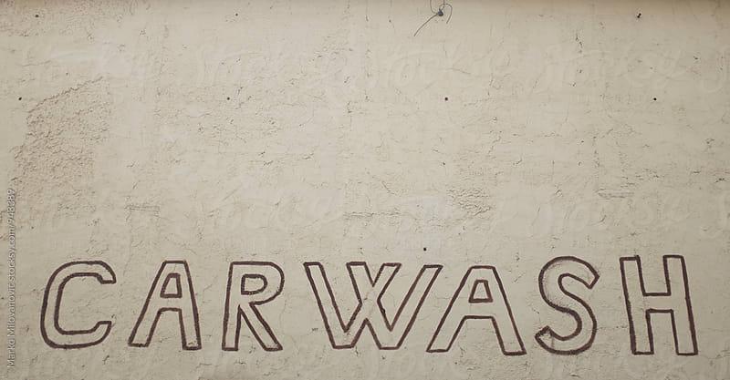 Carwash sign near the road by Marko Milovanović for Stocksy United
