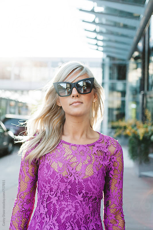 Beautiful woman wearing pink lace and sunglasses by Carey Shaw for Stocksy United