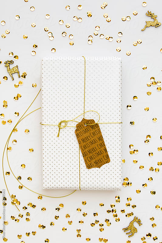 White and gold Christmas gift by Pixel Stories for Stocksy United