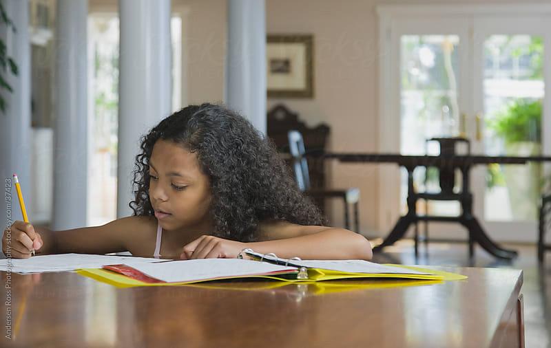 Girl (12-13) doing homework  by Andersen Ross Photography for Stocksy United