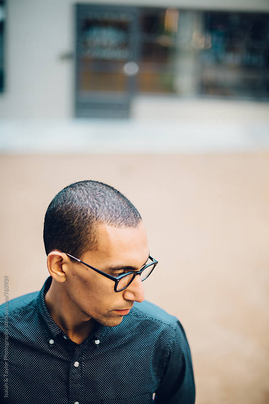 Portrait of young man outside by Isaiah & Taylor Photography for Stocksy United