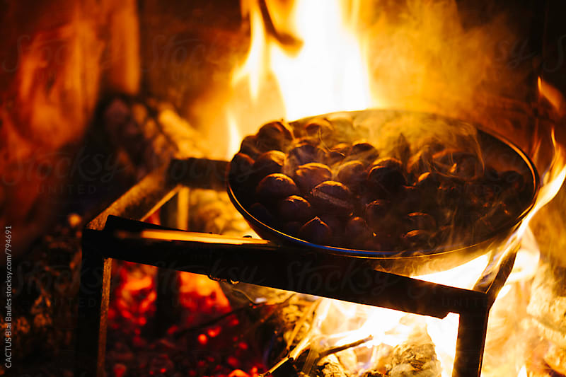 Bonfire cooking chestnuts by Blai Baules for Stocksy United