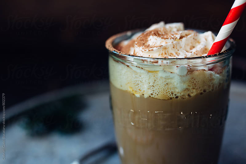 Cappuccino glass topped with cream by Gabriel (Gabi) Bucataru for Stocksy United