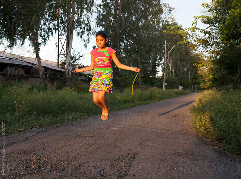 Teenage Girl playing and making fun with jumping rope by PARTHA PAL for Stocksy United