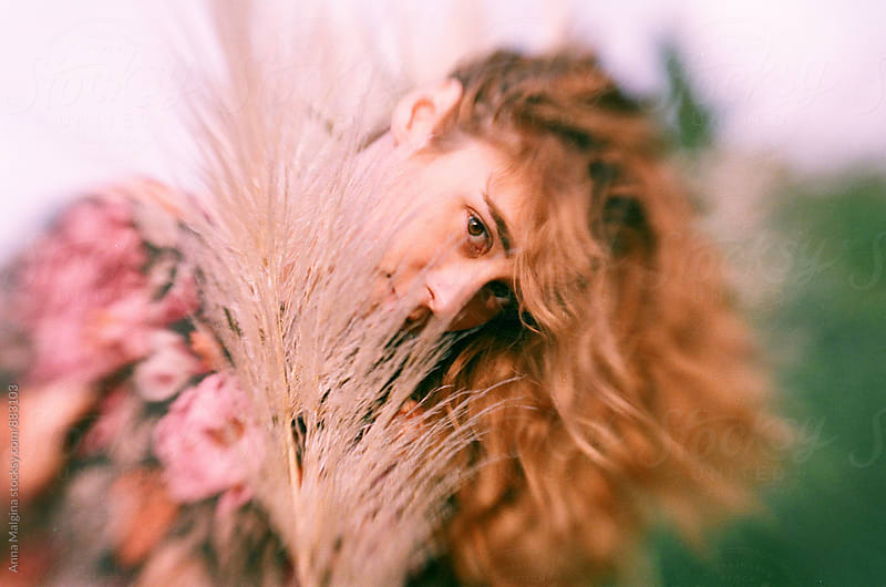 A film portrait of redhead woman made with expired film by Anna Malgina for Stocksy United