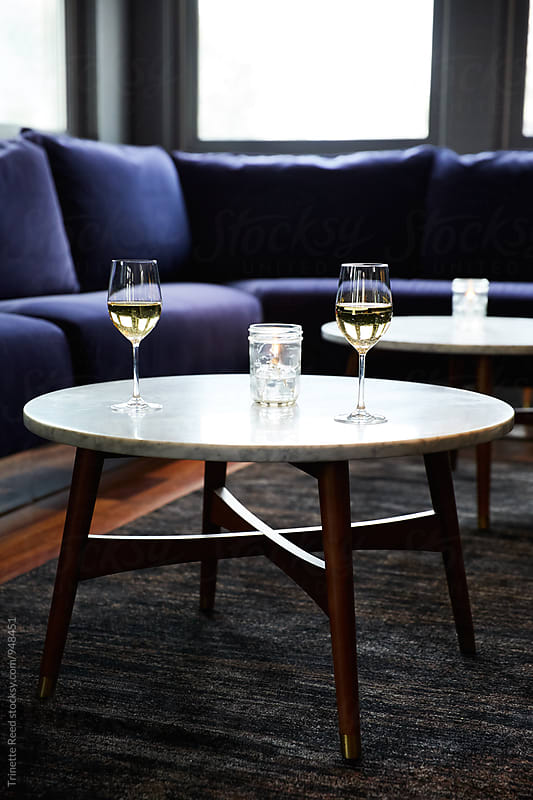 Wine glasses in empty cocktail lounge by Trinette Reed for Stocksy United