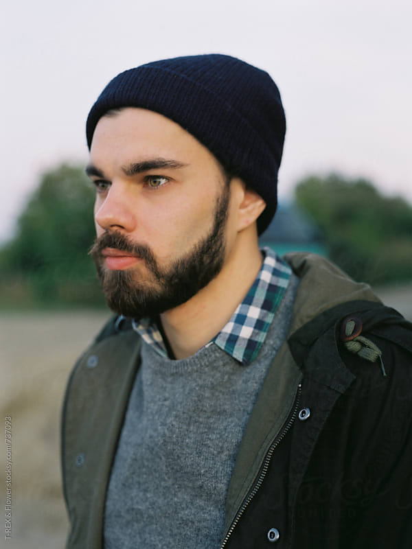 Bearded man looking into the distance by Danil Nevsky for Stocksy United