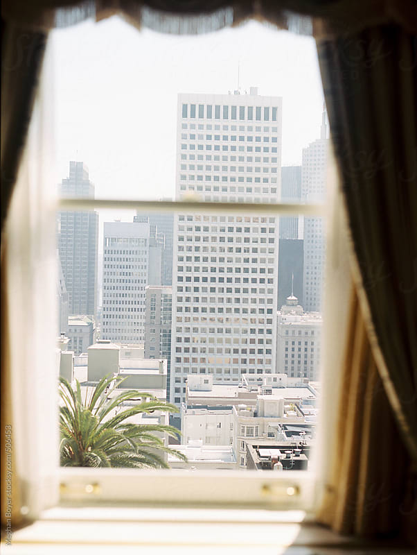 Through the hotel window by Meghan Boyer for Stocksy United