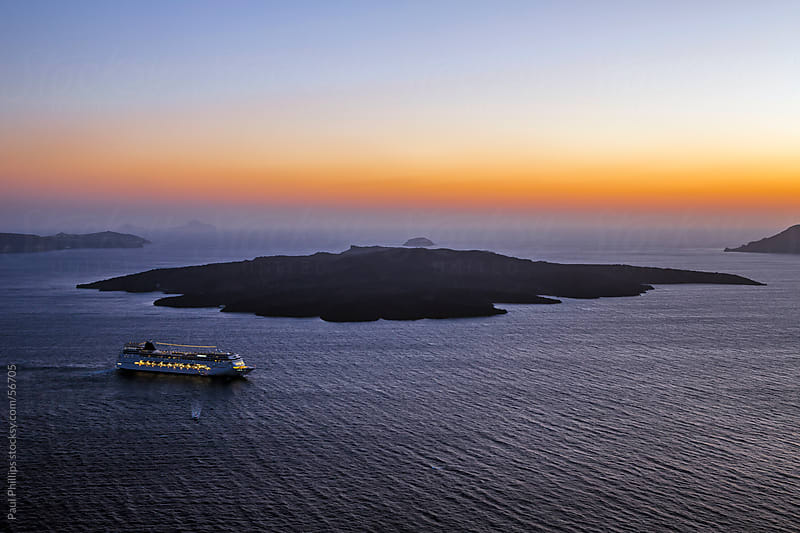 Ship leaving the caldera of Santorini, Greece by Paul Phillips for Stocksy United