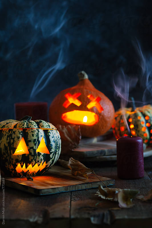 Halloween: Spooky jack-o-lanterns with smoke. by Darren Muir for Stocksy United