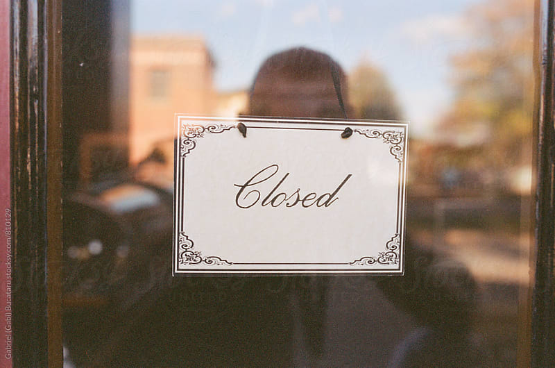 Closed sign on an old-fashioned store by Gabriel (Gabi) Bucataru for Stocksy United