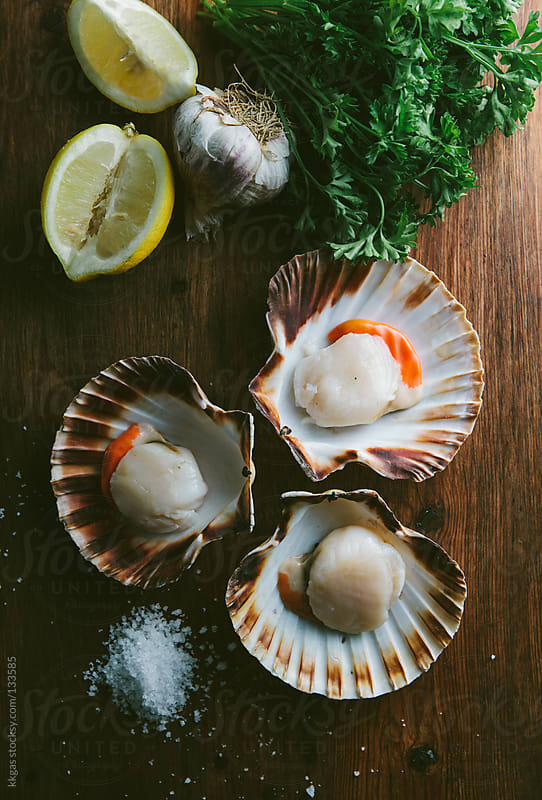 Raw Scallops with lemon and sea salt. by kkgas for Stocksy United