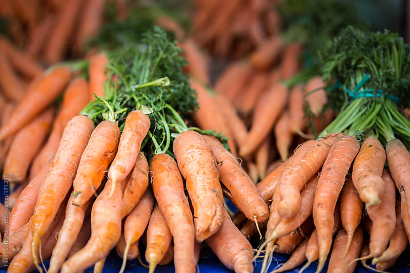 Carrots in the open market by Helen Sotiriadis for Stocksy United