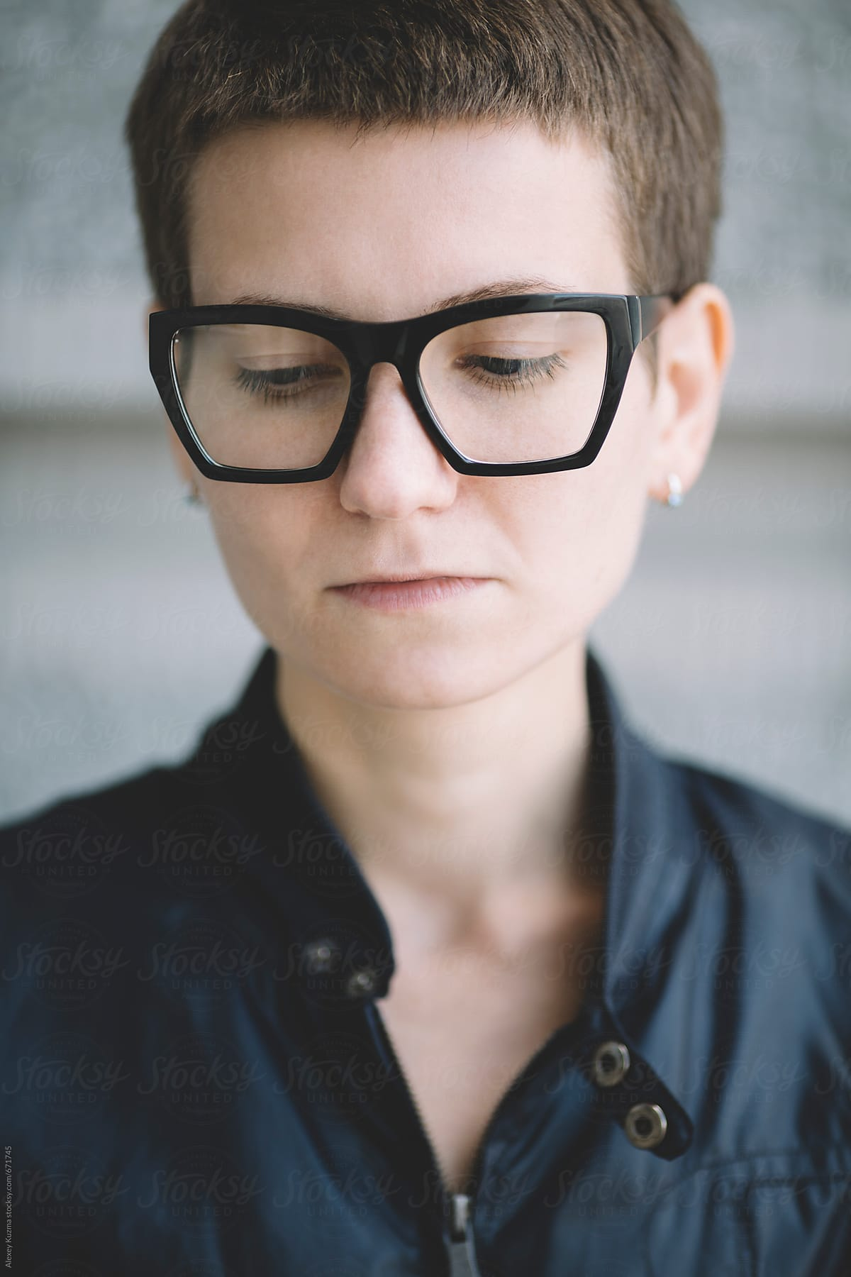 closeup of young lesbian woman with glasses and short hair
