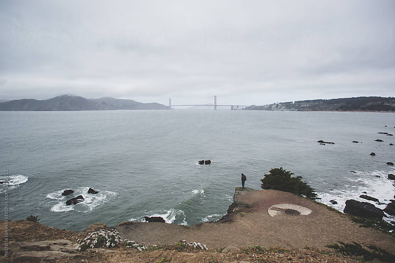 Man looking at the San Francisco bay by michela ravasio for Stocksy United