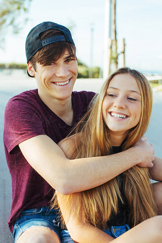 Portrait of smiling teenage couple. by BONNINSTUDIO for Stocksy United