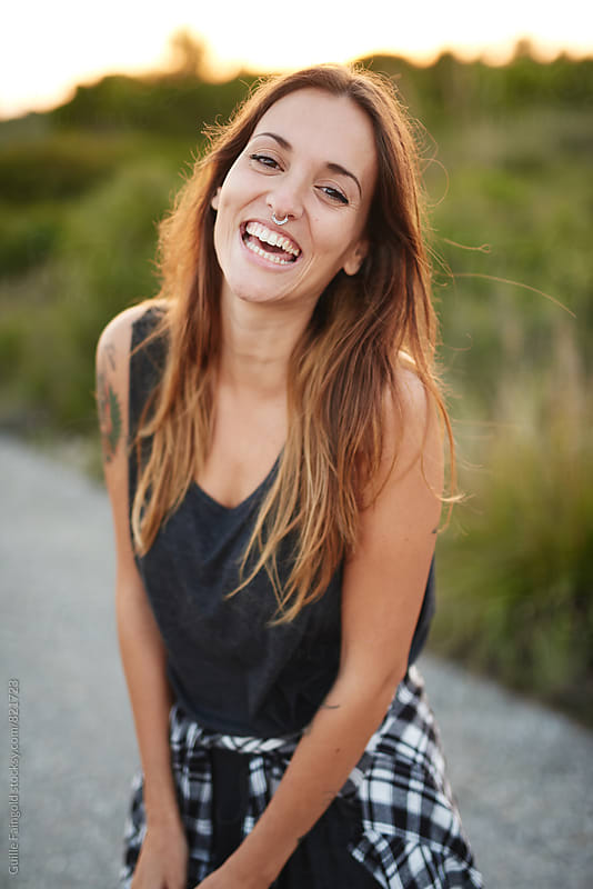 Portrait of pretty laughing woman by Guille Faingold for Stocksy United