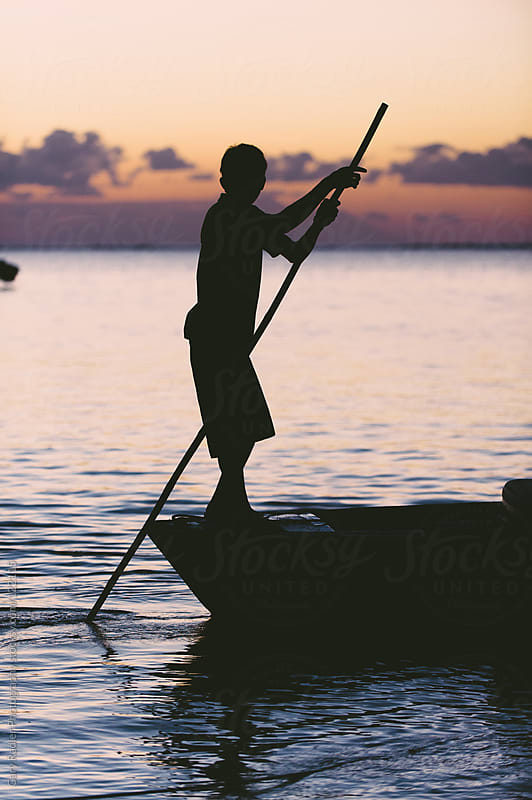 Silhouette of a Man on the Rear of a Canoe by Gary Radler Photography for Stocksy United