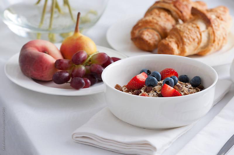 muesli fresh fruit and croissant breakfast by Lee Avison for Stocksy United
