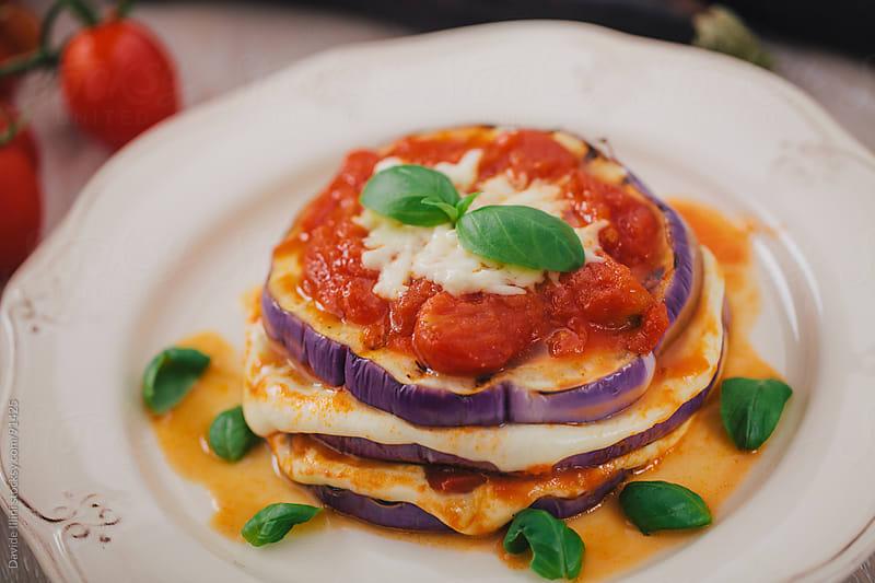 Eggplants Parmigiana by Davide Illini for Stocksy United