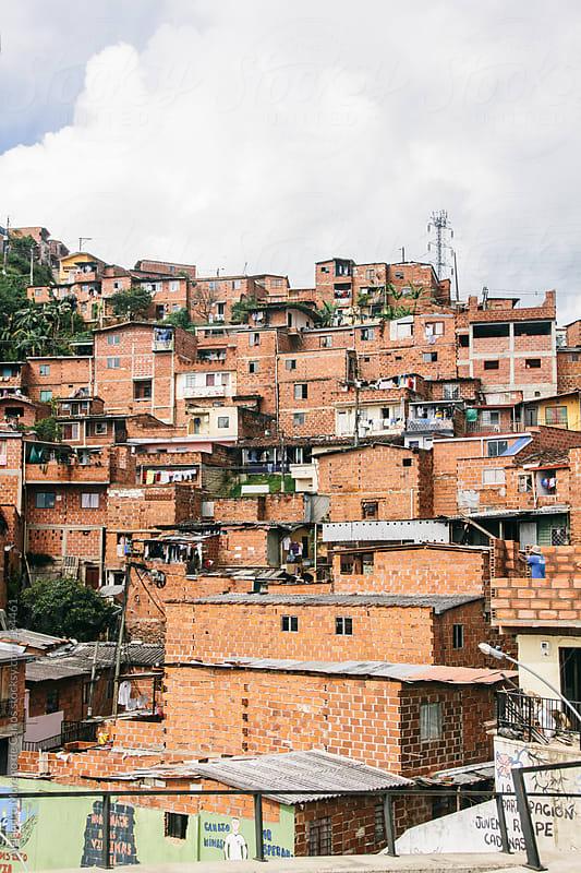 Houses and buildings made of bricks in slum in Medellin, Colombia by Alejandro Moreno de Carlos for Stocksy United