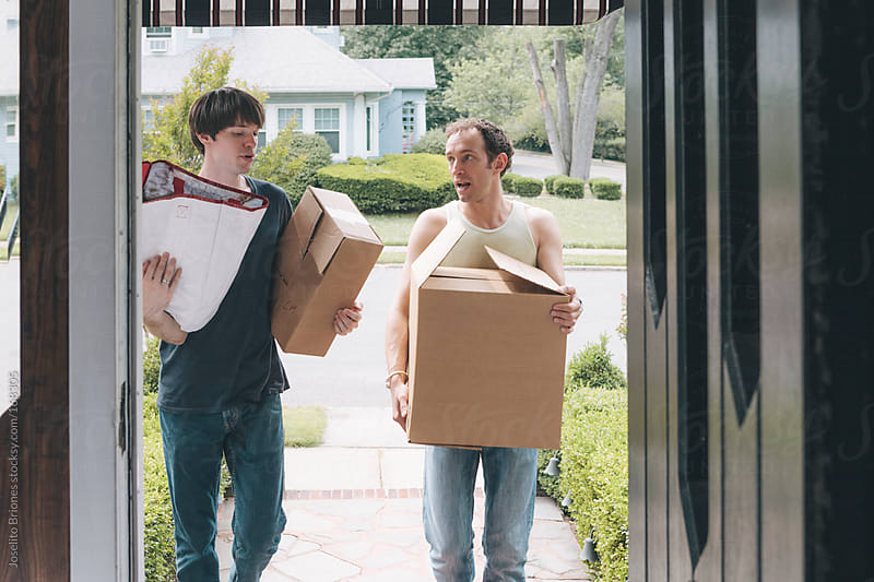Gay Couple Moving in Together to a Suburban Home by Joselito Briones for Stocksy United